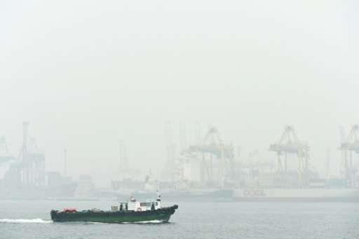 """Singapore's Keppel container port terminal is blanketed in thick smog as air quality reached """"very unhealthy"""" levels i"""