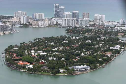 Single family homes on islands and condo buildings on ocean front property are seen in Miami Beach, Florida