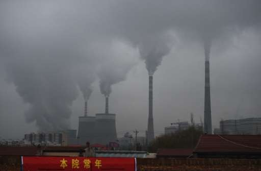 Smoke belches from a coal-fueled power station near Datong, in China's northern Shanxi province