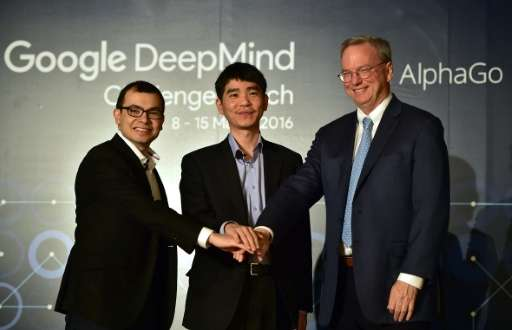 South Korean Go grandmaster Lee Se-Dol (C) with Google Deepmind head Demis Hassabis (L) and Eric Schmidt (R), the executive chai