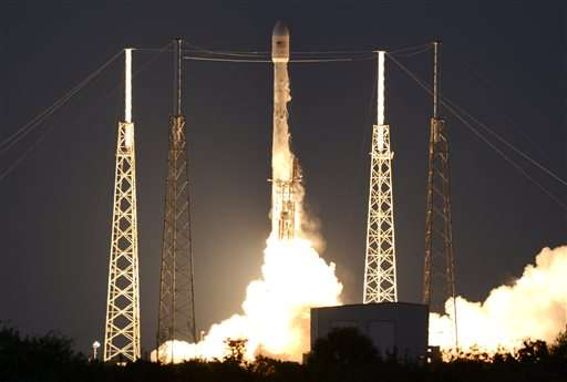 SpaceX launches satellite, but fails to land rocket on barge
