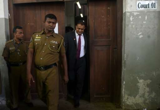 Suspended Sri Lankan judge Thilina Gamage (R) walks out of the High Court in Colombo on June 21, 2016, after being granted bail