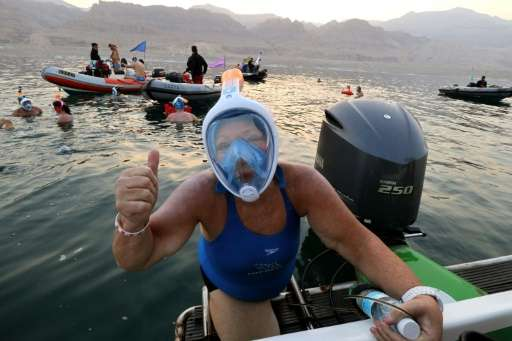 Swimmers taking part in a 17-kilometre swim from Jordan to Israel across the Dead Sea November 15, 2016 wore specially designed