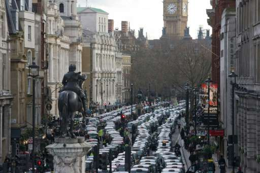 Taxi drivers block Whitehall as they demonstrate in central London on February 10, 2016
