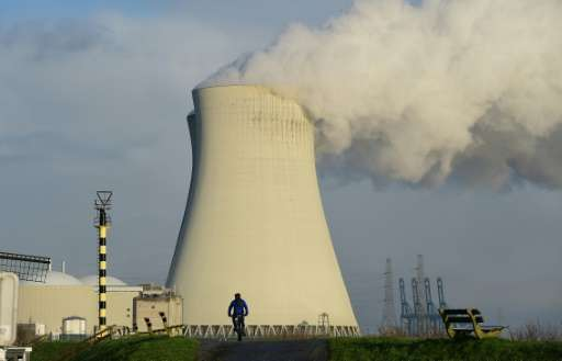 The cooling towers of Belgium's Doel nuclear plant belch thick white steam on January 12, 2016