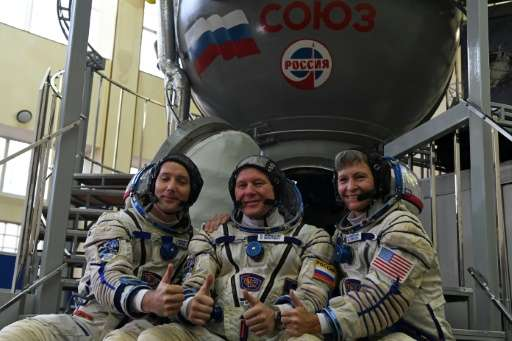The crew heading to the ISS is composed of NASA astronaut Peggy Whitson (R),French astronaut Thomas Pesquet (L) and Russian cos