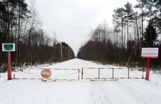 The entrance gate is closed to the sanitary protection zone around the Krasny Bor hazardous waste landfill near St. Petersburg