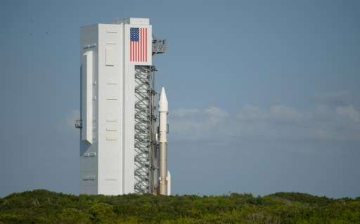 The United Launch Alliance Atlas V rocket with NASA OSIRIS-REx spacecraft on board rolls out of the Vertical Integration Facilit