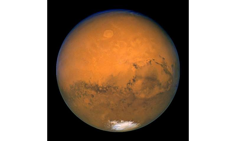 Today's Martian surface is considered too dry and radiation-blasted for living organisms to survive, but conditions would have b