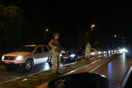 Turkish security officers stand on guard on the side of the road on July 15, 2016 in Istanbul, during a shutdown of the Bosphoru