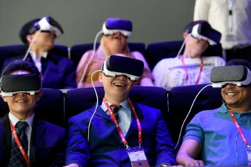 Visitors test the 'Oculus VR' virtual device on the Samsung stand at the Mobile World Congress in Barcelona on February 22, 2016