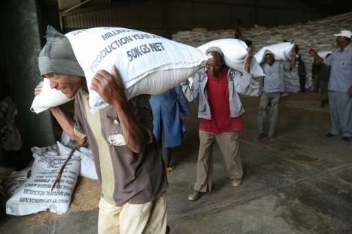 "Workers move emergency food supplies at Ethiopia's largest ""strategic grain reserve"" depot in Adama, on February 13, 2"