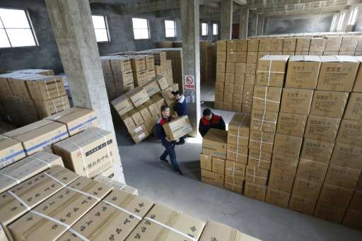 Workers stack boxes of pollution masks at the ASL Masks factory in Dongliu, China's Shandong province
