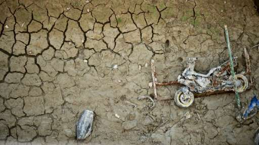 Wreckage of a motor-bike lies on the cracked riverbed of the Amadorio reservoir in Villajoyosa, Spain where the water is far bel