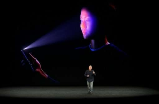 Apple senior vice president Philip Schiller shows the FaceID system which is being used on new iPhone X, allowing a user to unlo