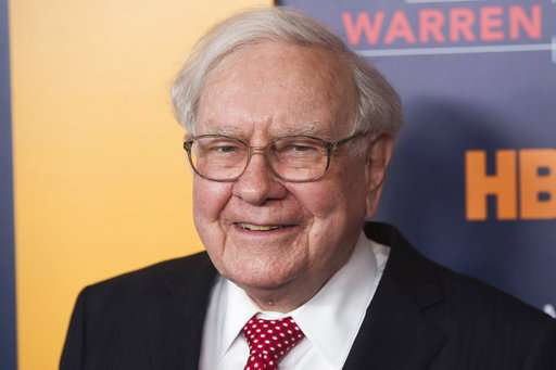 Buffett cuts stake in IBM and shares slide