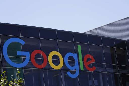 Google parent books $2.7B fine as European fight looms