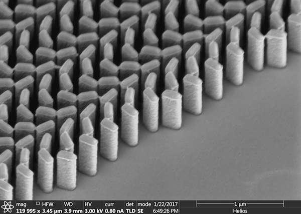 Immersion meta-lenses at visible wavelengths for nanoscale imaging