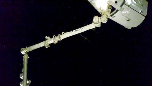 SpaceX capsule back at space station with pre-Christmas haul