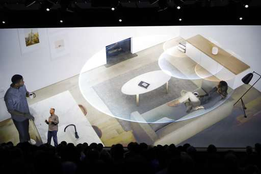 The Latest: Apple's HomePod speaker coming this year