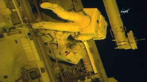 This NASA TV video grab shows astronauts Jack Fischer(top) and Peggy Whitson(below) as they make repairs outside the Internation