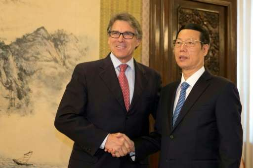 US Energy Secretary Rick Perry (left) shakes hands with China's Vice Premier Zhang Gaoli in Beijing on June 8, 2017