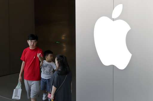 Workers at iPhone supplier in China protest unpaid bonuses