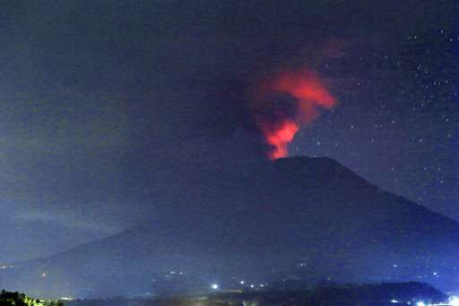 Bali volcano dusts resorts in ash; Lombok airport closes