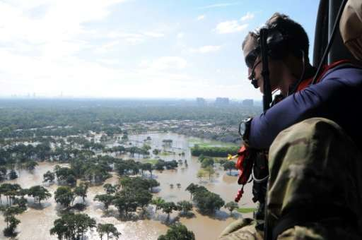 A member of the US Air National Guard surveys flood damage in Houston