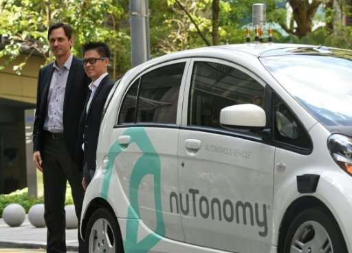 Autonomous cars developed by the US tech firm nuTonomy, such as one seen here in Singapore in 2016, will be hitting the streets