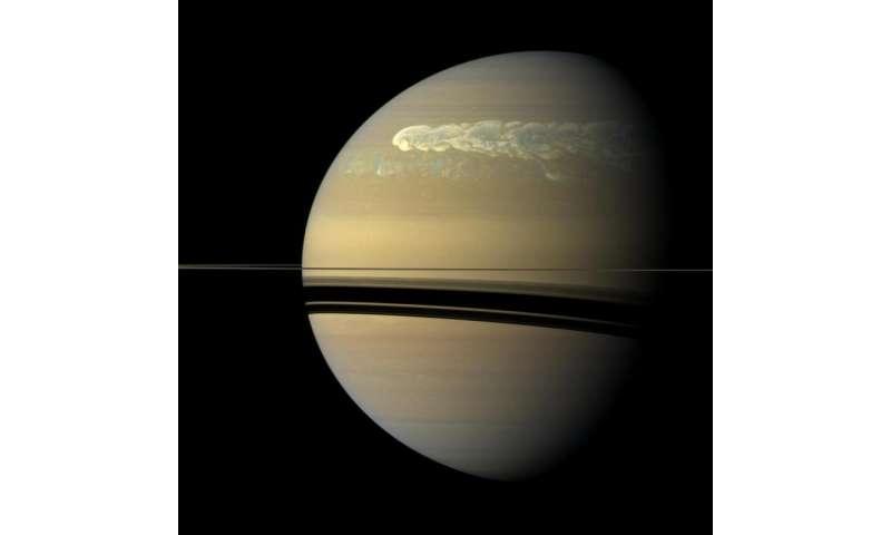 Cassini looks on as solstice arrives at Saturn