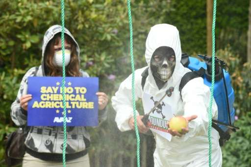 Demonstrators protest against the use of weedkiller glyphosate in Brussels on May 18, 2016