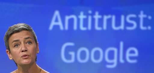 EU fines Google a record 2.4 billion euros in antitrust case
