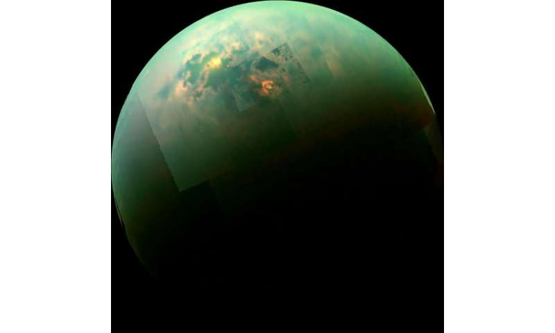 NASA's Cassini spacecraft captures a near-infrared, color mosaic on October 31, 2014, showing the sun glinting off of Titan's no