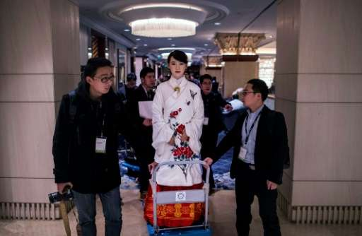 The humanoid robot 'Jia Jia' is carried by workers following a presentation at a conference in Shanghai, on January 9, 2017