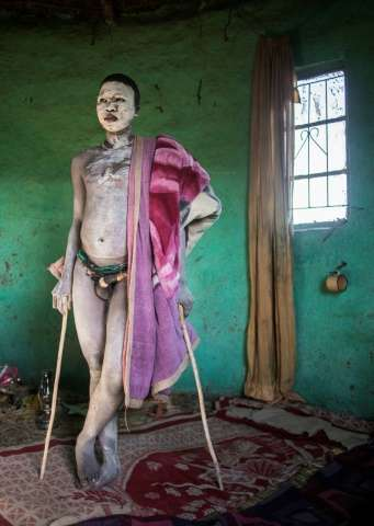 This file photo taken on July 11 shows traditional Xhosa initiate Fezikhaya Tselane, 20 years old, standing during a traditional