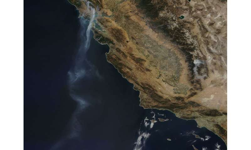 NASA satellite sees a tail of smoke over 500 miles long from California fires
