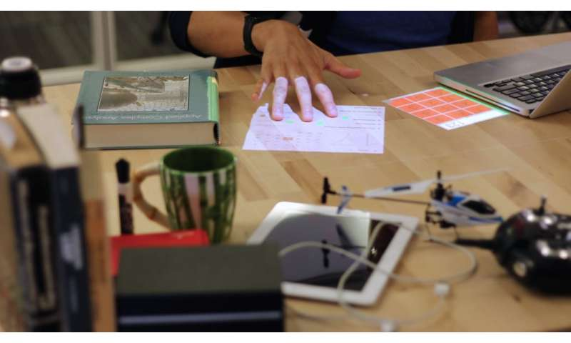 Researchers explore how a desk surface can serve as a touchscreen
