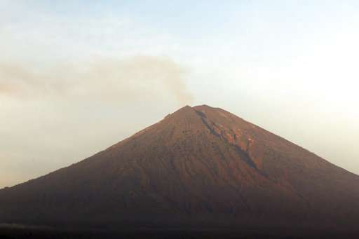 bali volcano emits wispy plume of steam flights resume