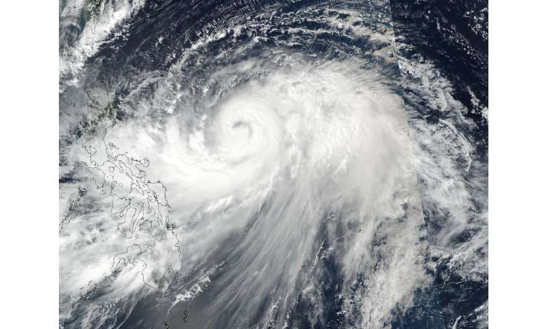 NASA sees intensifying Typhoon Lan stretch high in the troposphere