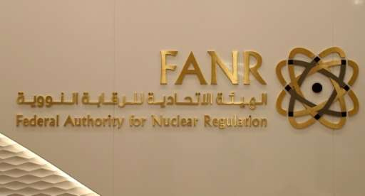 A picture taken on August 10, 2017 shows the sign and logo of the UAE's Federal Authority for Nuclear Regulation (FANR) at its p
