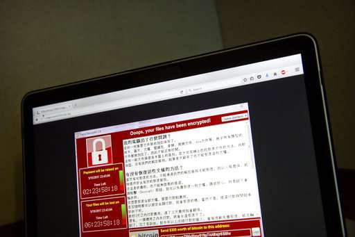 Experts: Cyberattack havoc could grow as work week begins