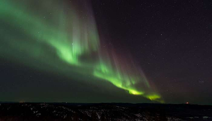 Mathematical model confirms the hypothesis of the origin of auroral sounds
