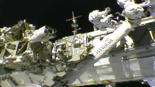 Spacewalkers install new hand on station's robot arm