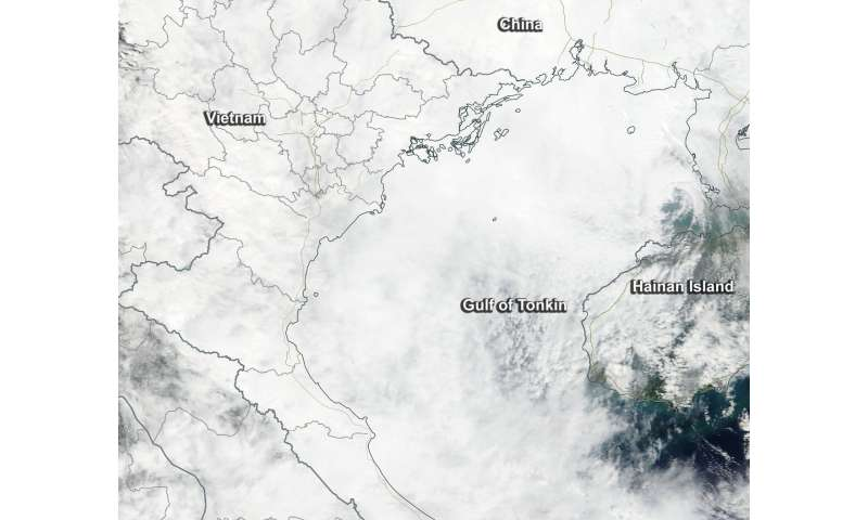 NASA sees Tropical Depression Khanun sissipating in Gulf of Tonkin