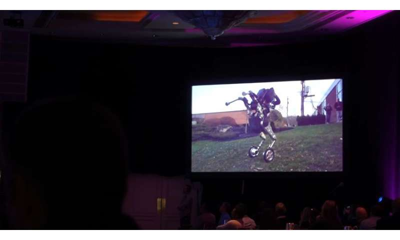 Handle: Boston Dynamics robot on wheels performs on stage
