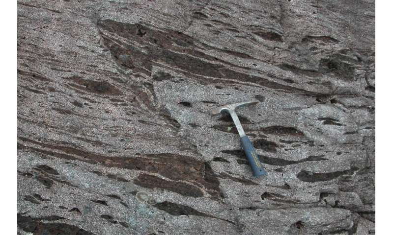 Garnet crystal microstructures formed during ancient earthquake provide evidence for seismic slip rates along a fault