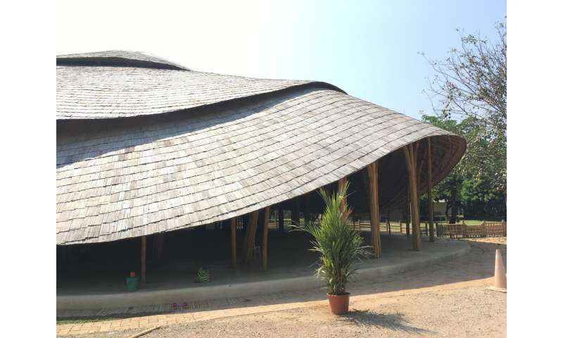 Sports hall for school in Thailand has bamboo construction