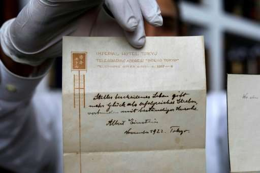 A picture taken on October 19, 2017 shows one of two notes written by Albert Einstein, in 1922, on stationary from the Imperial