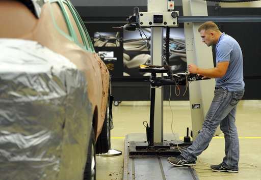 In a high-tech world, car designers still rely on clay